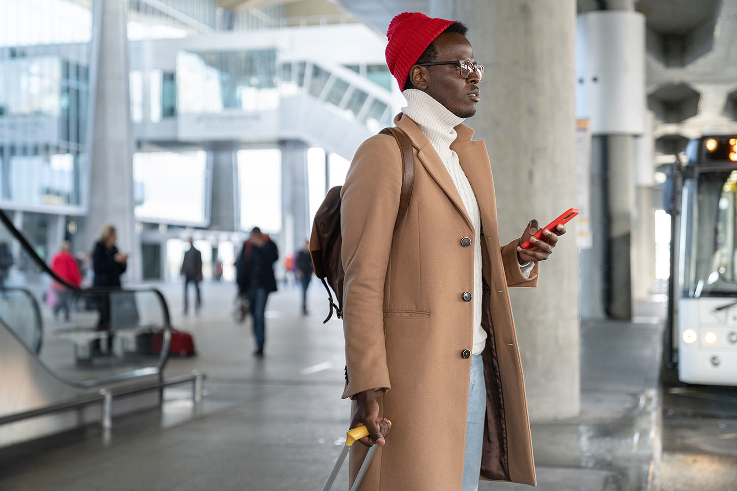 Man with red hat and cell phone.